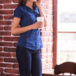 Woman talking on  phone and holding cup — Stock Photo #47718495
