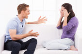 Man shouting and gesturing while woman sitting — Stock Photo
