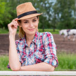 Woman adjusting cowboy hat — Stock Photo #47854701