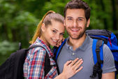 Loving couple with backpacks — Stock Photo