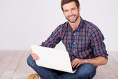 Handsome man with laptop. — Stock Photo