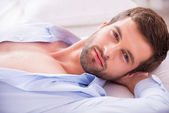 Young man in unbuttoned shirt — Stock Photo