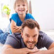 Boy lying on the back of his father — Stock Photo #48113637