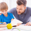Father helping his son with homework — Stock Photo #48113639