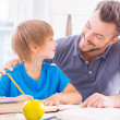 Father helping his son with homework — Stock Photo #48113661