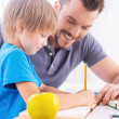 Father helping his son to do homework — Stock Photo #48113703