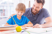 Father helping his son with homework — Stock Photo