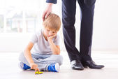 Sad little boy playing with toy car — Stock Photo