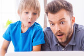 Surprised father and son — Stock Photo