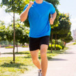 Man running along the road — Stock Photo #48419863