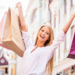 Woman holding shopping bags — Stock Photo #48428843