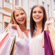 Women holding shopping bags — Stock Photo #48428999