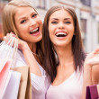 Women holding shopping bags — Stock Photo #48429033