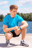 Man checking time before jogging — Stock Photo