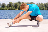 Man doing stretching exercises — Stock Photo