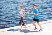 Woman and man jogging together. — Stock Photo