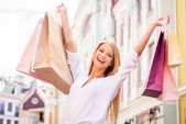 Woman holding shopping bags — Stock fotografie