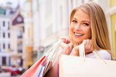 Woman holding shopping bags — Stock Photo