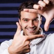 Man in white sweater gesturing finger frame — Stock Photo #48814391