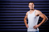 Sporty young man in tank top — Stock Photo