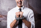 Businessman trapped in chains — Stock Photo