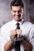 Businessman trapped in chains. — Stock Photo