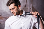 Man taking off his necktie — Stock Photo