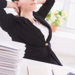 Businesswoman holding head in hands — Stock Photo #48898439