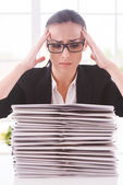 Woman in suit tie looking at the stack of paperwork — Foto Stock