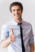 Man in shirt and tie showing his thumb up — Stock Photo