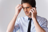 Man in shirt and tie talking on the mobile phone — Stock Photo