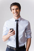 Man in formalwear holding mobile phone — Stock Photo