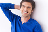 Handsome young man in blue sweater — Stock Photo