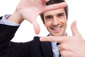 Man in formalwear gesturing finger frame — Stock Photo