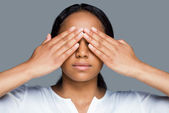 African woman covering eyes — Stock Photo