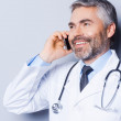 Doctor talking on the mobile phone — Stock Photo