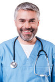 Happy mature surgeon in blue uniform — Stock Photo