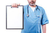 Doctor showing clipboard with copy space — Stock Photo