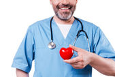 Cardiology surgeon holding heart shape toy — Stock Photo