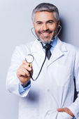 Doctor examining you with stethoscope — Stock Photo