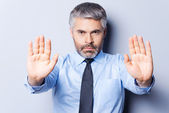 Man in shirt and tie showing his palms — Stock Photo