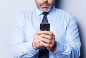 Businessman typing messages — Foto de Stock