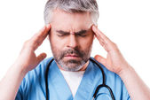 Surgeon touching his head with hands — Stock Photo