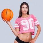 Woman cheerleader holding basketball ball — Stock Photo #49541997