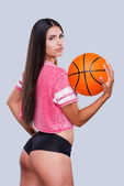Woman cheerleader holding basketball ball — Stock Photo