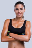 Woman in sports clothing keeping arms crossed — Stock Photo