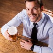 Man in shirt and tie holding glass with beer — Stock Photo #49601691