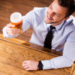 Man in shirt and tie examining glass with beer — Stock Photo #49601817