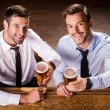 Men in shirt and tie holding glasses with beer — Stock Photo #49601857