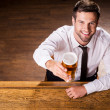 Man in shirt and tie holding glass with beer — Stock Photo #49601871